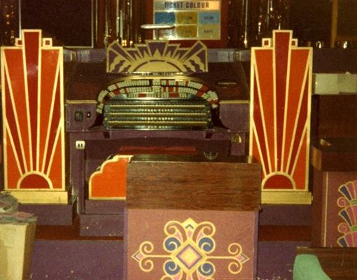 The Mighty Compton Organ with boarded front following an incident which broke the glass surround, painted and not at its glorious restored best