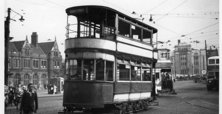 Trams still running from Mersey Square with The Plaza in the background