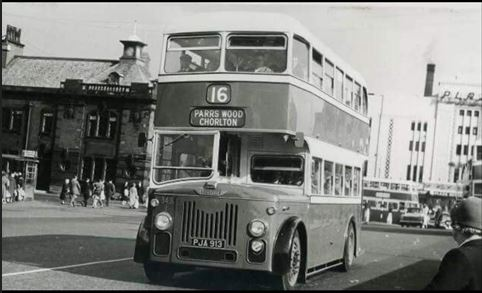 The No.16 heading from Stockport Bus Terminus to Parrs Wood & Chorlton with The Plaza watching on in the background