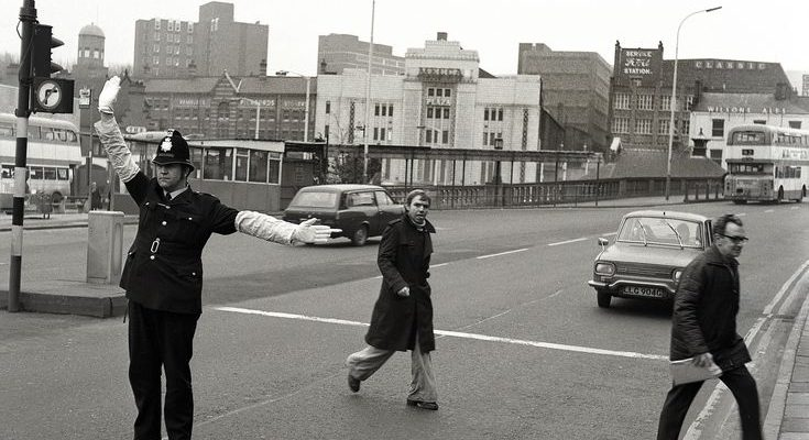 Police Patrol on Wellington Road South with The Plaza/Mecca in the background