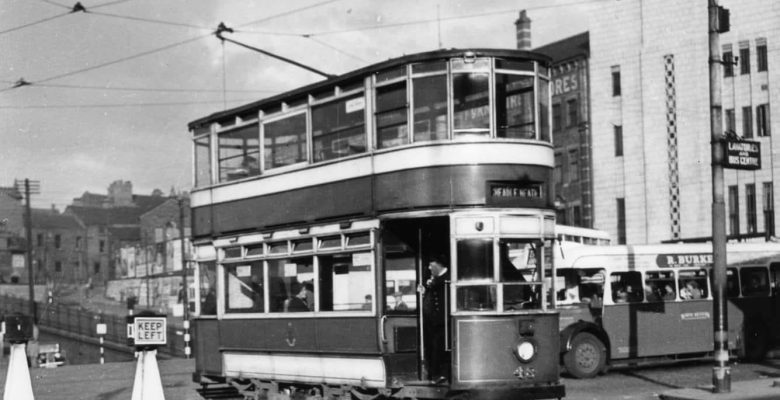 Tram passing The Plaza Facade when Mersey Square was the hub of local transport