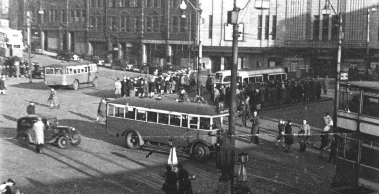 Bus Terminus crowds outside The Plaza on Mersey Square